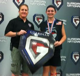 Kady Glynn (right) accepts first place award from Ginny Capicchioni