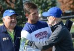 Penn coach and new HEADstrong Quakers partner Mike Murphy (middle) embraces HEADstrong Hero Marshall Jensen at the University City Classic.. Thy are joined by Pat Colleluori Sr. (left) .